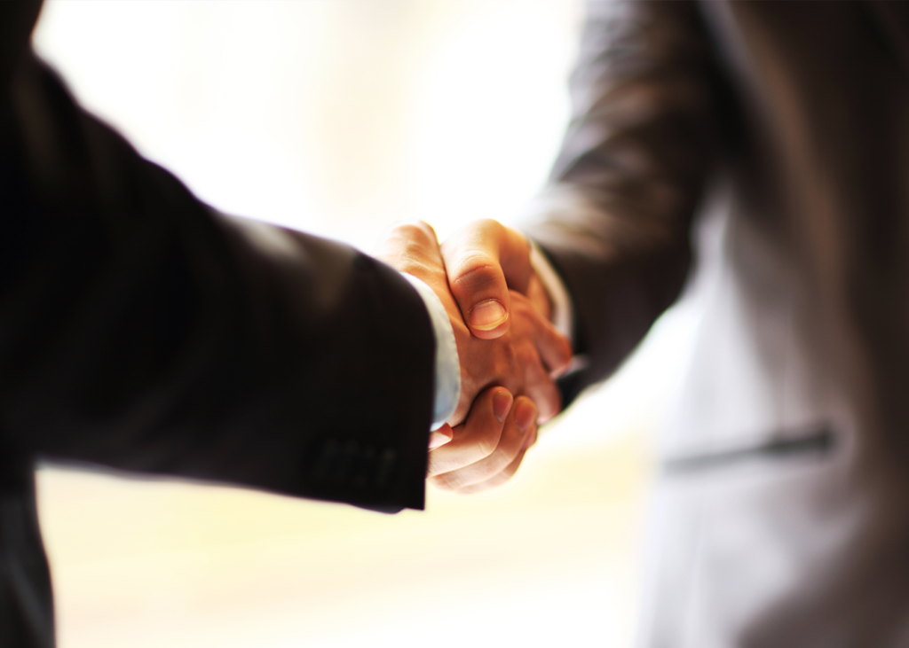 Shaking hands at networking event
